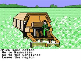 In game image of The Spy's Adventures in North America on the Commodore 64.