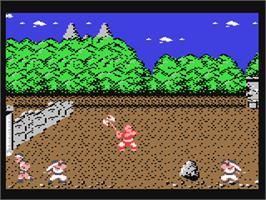 In game image of Tiger Road on the Commodore 64.