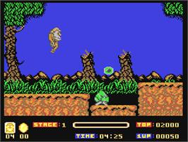 In game image of Toki: Going Ape Spit on the Commodore 64.