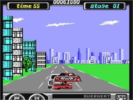 In game image of Turbo Outrun on the Commodore 64.