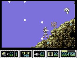 In game image of Turrican II: The Final Fight on the Commodore 64.