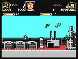 In game image of U.N. Squadron on the Commodore 64.
