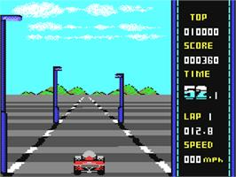 In game image of WEC Le Mans on the Commodore 64.