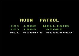 Title screen of Moon Patrol on the Commodore 64.