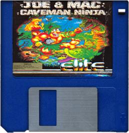 Cartridge artwork for Joe & Mac: Caveman Ninja on the Commodore Amiga.