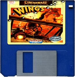 Cartridge artwork for Wings on the Commodore Amiga.