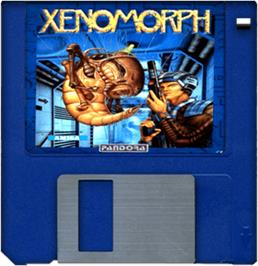 Cartridge artwork for Xenomorph on the Commodore Amiga.