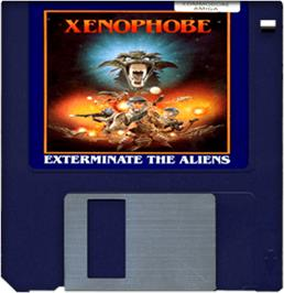 Cartridge artwork for Xenophobe on the Commodore Amiga.