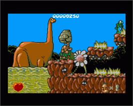 In game image of Chuck Rock on the Commodore Amiga.