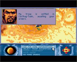 In game image of Dune 2 on the Commodore Amiga.