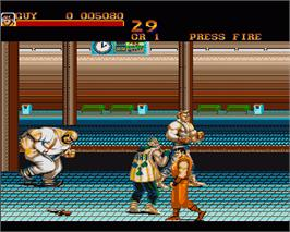 In game image of Final Fight on the Commodore Amiga.