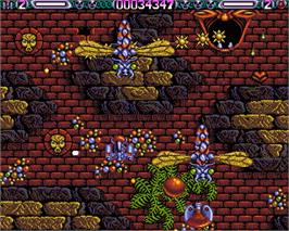 In game image of Lethal Xcess: Wings of Death 2 on the Commodore Amiga.