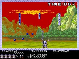 In game image of Pang on the Commodore Amiga.