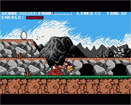 In game image of Prehistorik on the Commodore Amiga.