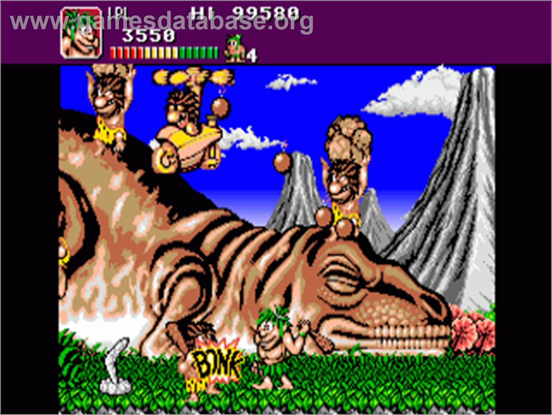 In game image of Joe & Mac: Caveman Ninja on the Commodore Amiga.