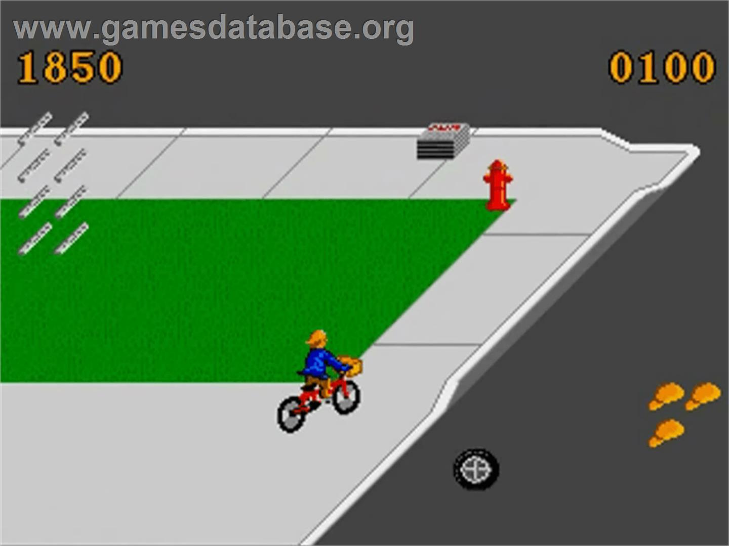 In game image of Paperboy on the Commodore Amiga.