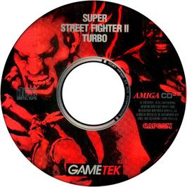 Artwork on the CD for Super Street Fighter II Turbo on the Commodore Amiga CD32.