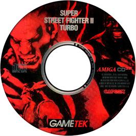 Artwork on the Disc for Super Street Fighter II Turbo on the Commodore Amiga CD32.