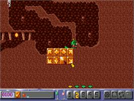 In game image of Diggers & Oscar on the Commodore Amiga CD32.