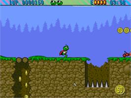 In game image of Super Frog on the Commodore Amiga CD32.