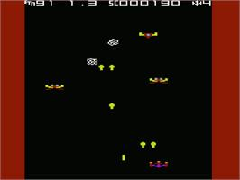 In game image of Galaxian on the Commodore VIC-20.