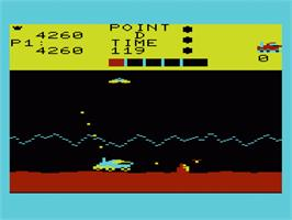 In game image of Moon Patrol on the Commodore VIC-20.