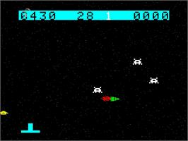 In game image of Space Raiders on the Emerson Arcadia 2001.