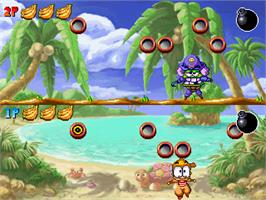 In game image of Woody & Kunta - Treasure Island on the Gamepark GP32.