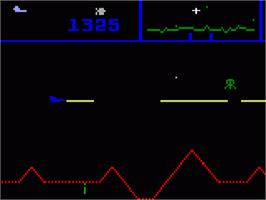 In game image of Defender on the Mattel Intellivision.