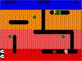 In game image of Dig Dug on the Mattel Intellivision.
