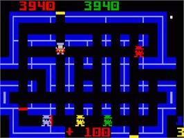 In game image of Lock'n'Chase on the Mattel Intellivision.