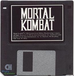 Artwork on the Disc for Mortal Kombat on the Microsoft DOS.
