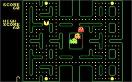 In game image of Pac Man on the Microsoft DOS.