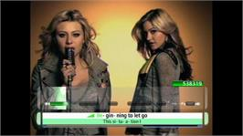In game image of Disney Sing It on the Microsoft Xbox 360.