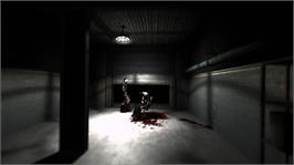 In game image of F.E.A.R. on the Microsoft Xbox 360.