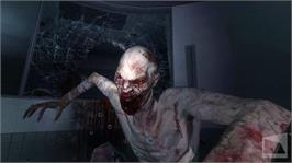 In game image of F.E.A.R. 2 on the Microsoft Xbox 360.