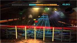 In game image of Rocksmith on the Microsoft Xbox 360.