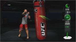 In game image of UFC Personal Trainer on the Microsoft Xbox 360.