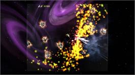 In game image of Asteroids & Deluxe on the Microsoft Xbox Live Arcade.