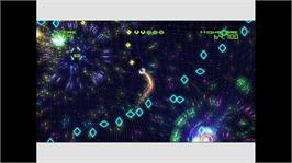 In game image of Geometry Wars Evolved on the Microsoft Xbox Live Arcade.