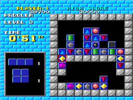 In game image of Puzznic on the NEC PC Engine.