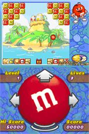 In game image of M&M's Break' Em on the Nintendo DS.
