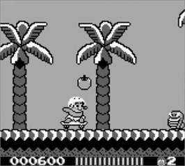 In game image of Adventure Island on the Nintendo Game Boy.