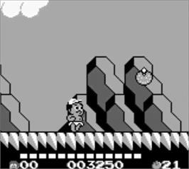 In game image of Adventure Island II - Aliens in Paradise on the Nintendo Game Boy.