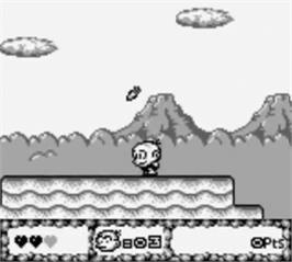 In game image of Bonk's Adventure on the Nintendo Game Boy.