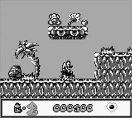 In game image of Chuck Rock on the Nintendo Game Boy.