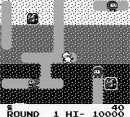 In game image of Dig Dug on the Nintendo Game Boy.