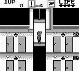 In game image of Elevator Action on the Nintendo Game Boy.