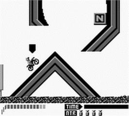In game image of Motocross Maniacs on the Nintendo Game Boy.