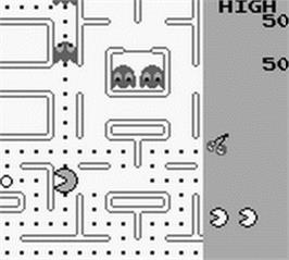 In game image of Pac-Man on the Nintendo Game Boy.
